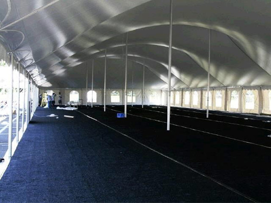 large tent with a black carpet