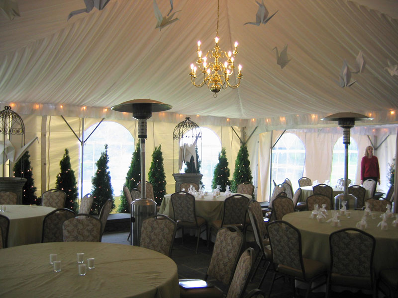 tables & chairs set up under tent