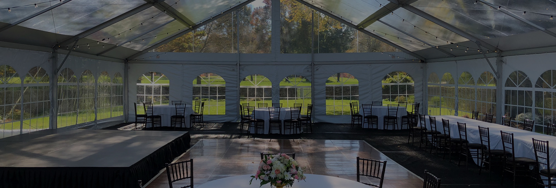Clear tent with tables & chairs